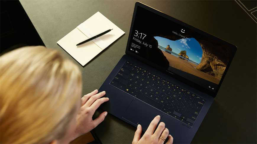 women working on refurbished zenbook laptop